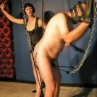 Two hot latex mistresses humiliate and train their disobedient male slave