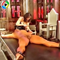 Hot domina in little black latex dress whips sub's ass then bondages him