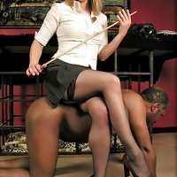 Young dominant lady plays with her ebony slave making him to serve her