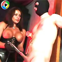 Mistress Carly jerks her submissive gimps cock nice and hard because she wants a big and messy load.