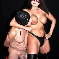 Mistress Carly cages her slaves cock and then torments him with her gorgeous body until he cums on her boots.