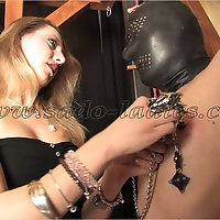 Young tortures the nipples of a chained slave.