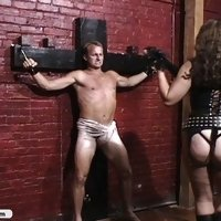 Two cruel bitches torture captured spy in their dungeon