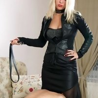 Blonde in black feeds her slave and bruises him with sharp heels