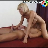 Terrific blonde dominatrix cheers her hungry slave up with a tender handjob while facesitting him