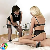 Two mistresses cock teasing bound slave