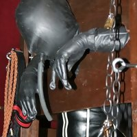 Empress M disciplines her rubber slave and gives him something to drink.