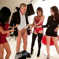 Horny photographer gets stripped, laughed at and wanked by three stunners