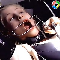 Mistress in latex nurse suit prepares a cute girl for training gagging her