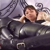 Mistress redresses a submissive woman in bondage before next session