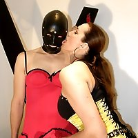 Busty femdom shags masked gimp then dresses him up